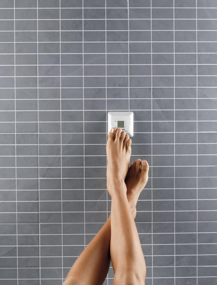 feet on thermostat